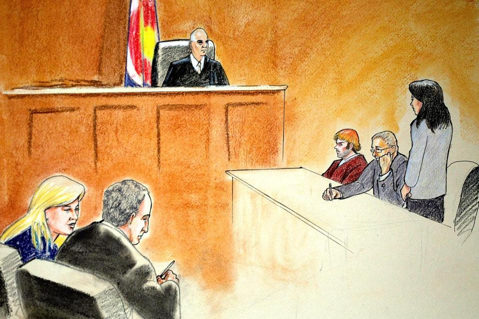 In this courtroom sketch, suspect James Holmes, third from the right, was arraigned Monday on charges related to the shooting rampage at an Aurora, Colo. movie theater on July 20.