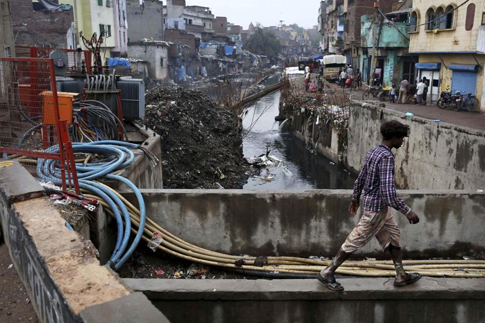 An Indian man walked past cables and exposed wires at an electricity substation in New Delhi, India, Wednesday.