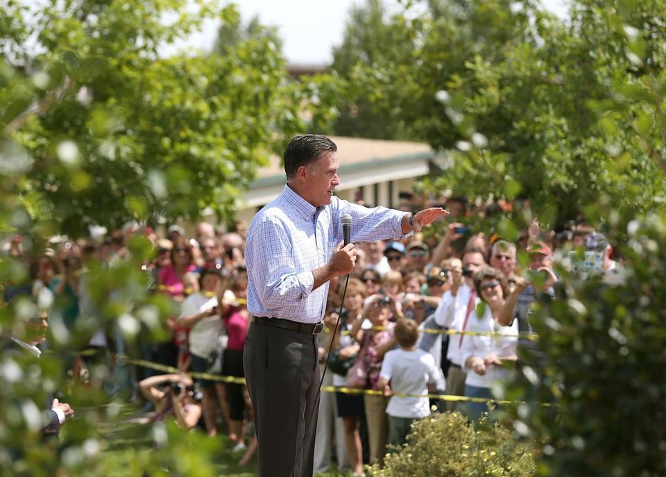 Mitt Romney spoke to an overflow crowd Wednesday during a campaign stop at a fairgrounds in Golden, Colo.