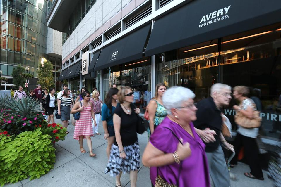 Summer crowds strolled by restaurants and bars near the Paramount Center in Downtown Crossing.