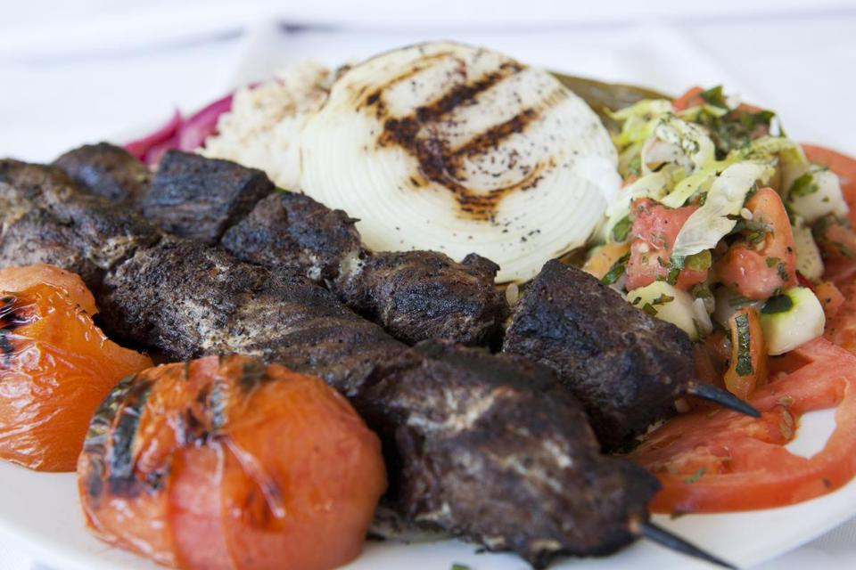 At Cafe Beirut in Jamaica Plain, lamb kebab with rice pilaf and homemade pickles and moujadara.
