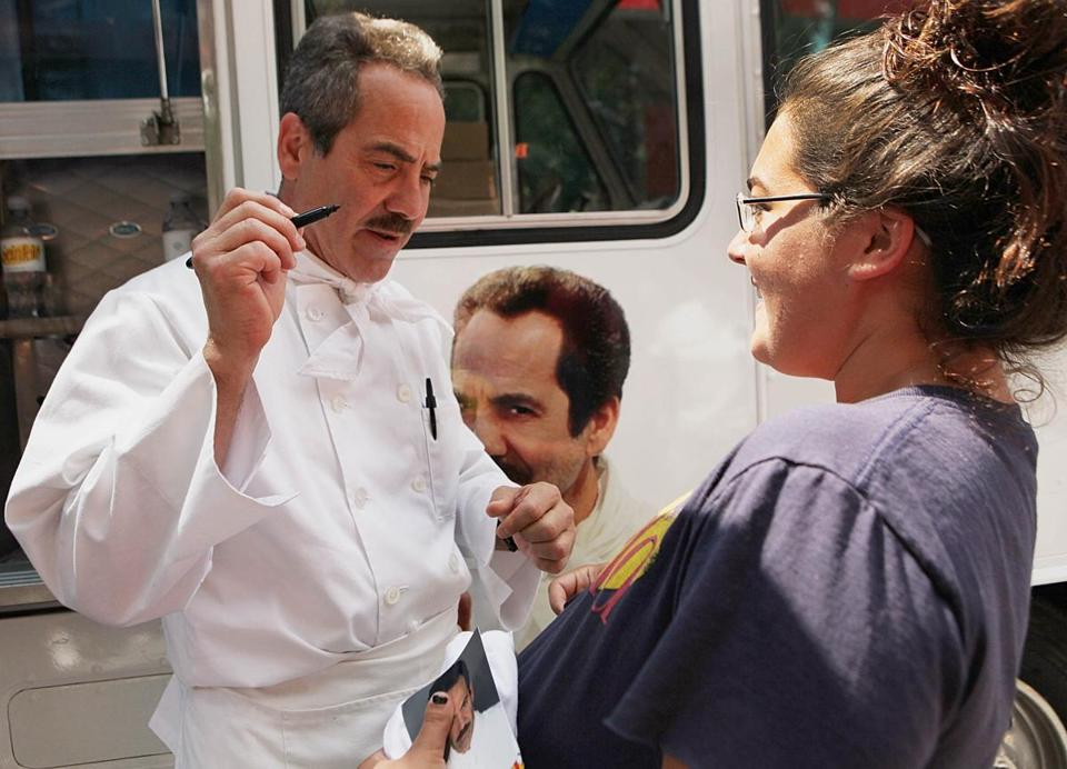 "BOWLED OVER: ""Soup Nazi"" Larry Thomas signs Kaili Martin's shirt at the traveling Seinfeld Food Truck; Harvard Square on August 3"