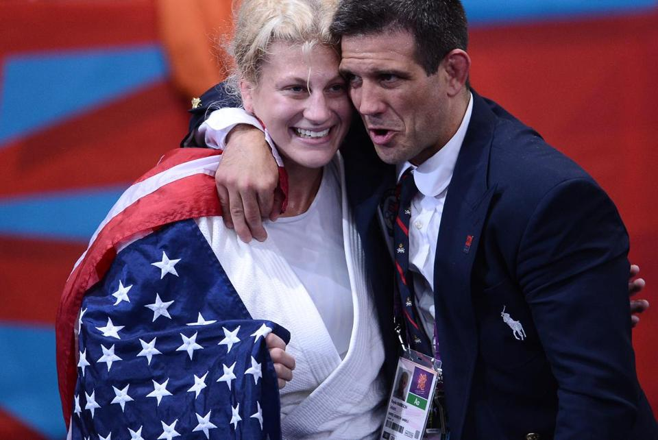 Kayla Harrison celebrated with her coach after Thursday's Gold-medal victory.