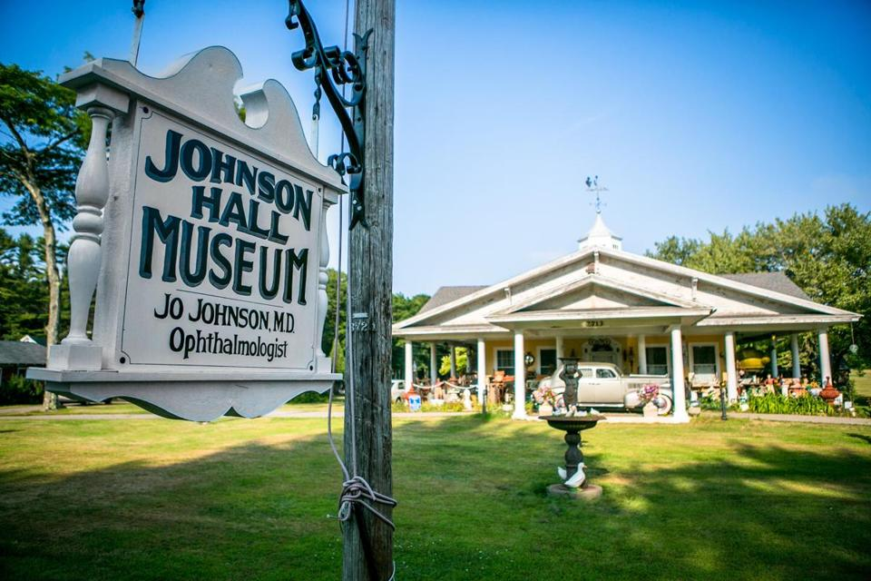 A view of Bill Johnson's eclectic museum from the street, which he says would be obscured if he plants the trees that Wells, Me., officials say he must.