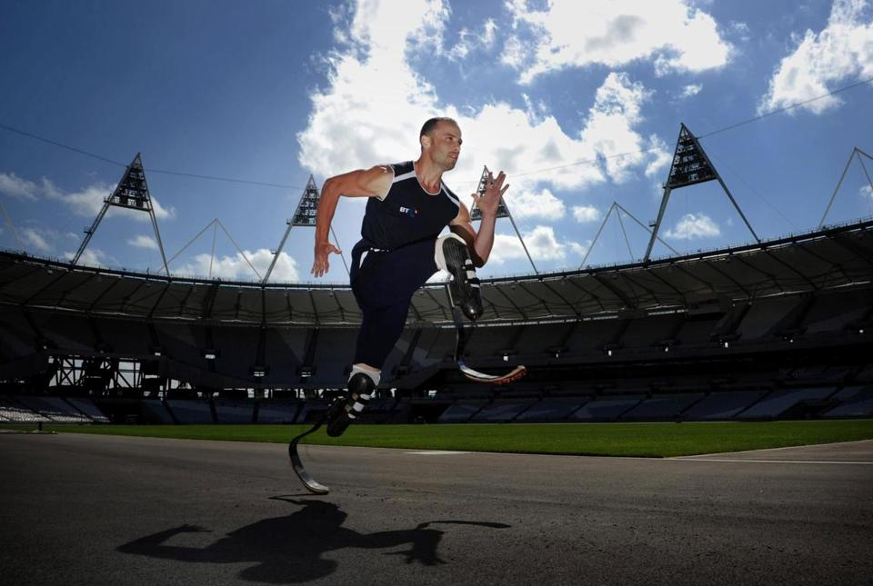 Oscar Pistorius of South Africa runs on carbon-fiber prostheses.