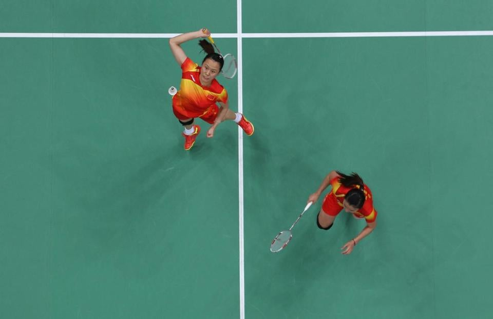 Zhao Yunlei (left) and Tian Qing of China gave it their all in a thrilling victory over Japan in the gold-medal match.
