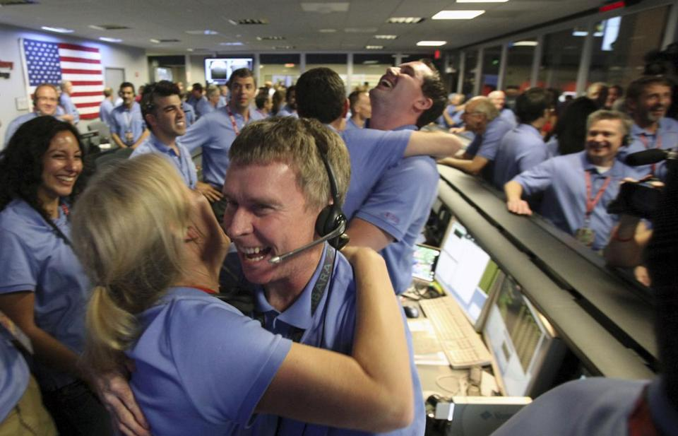 Employees at NASA's Jet Propulsion Lab in Pasadena, Calif., celebrated the landing of the space agency's Curiosity rover on Mars Monday.