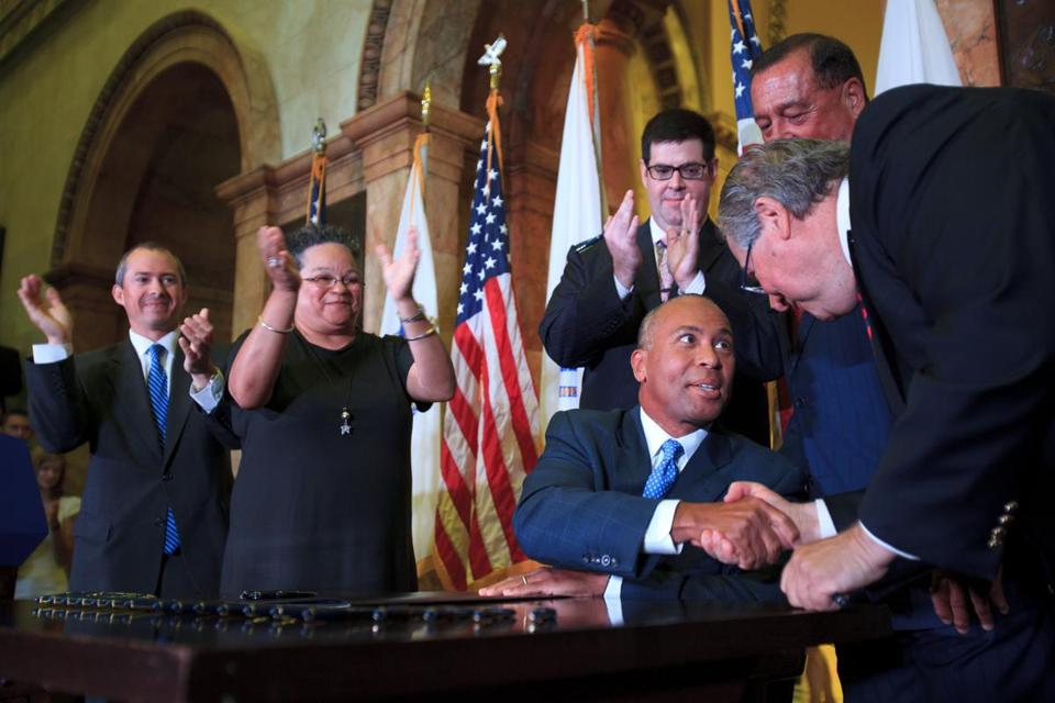 Governor Deval Patrick shook hands with Speaker of the House Robert DeLeo after signing a health care cost containment bill into law on Monday morning.