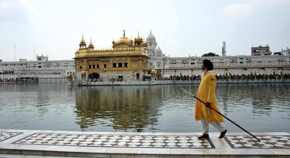 A Sikh holyman guarded a walkway at the Golden Temple, Sikh's holiest shrine in Amritsar, India.