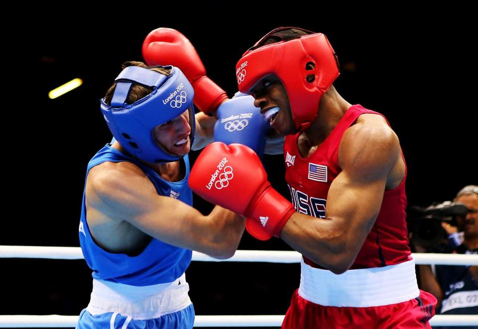 Errol Spence of US, right, lost to Andrey Zamkovoy of Russia in the quarterfinals of the welterweight class.