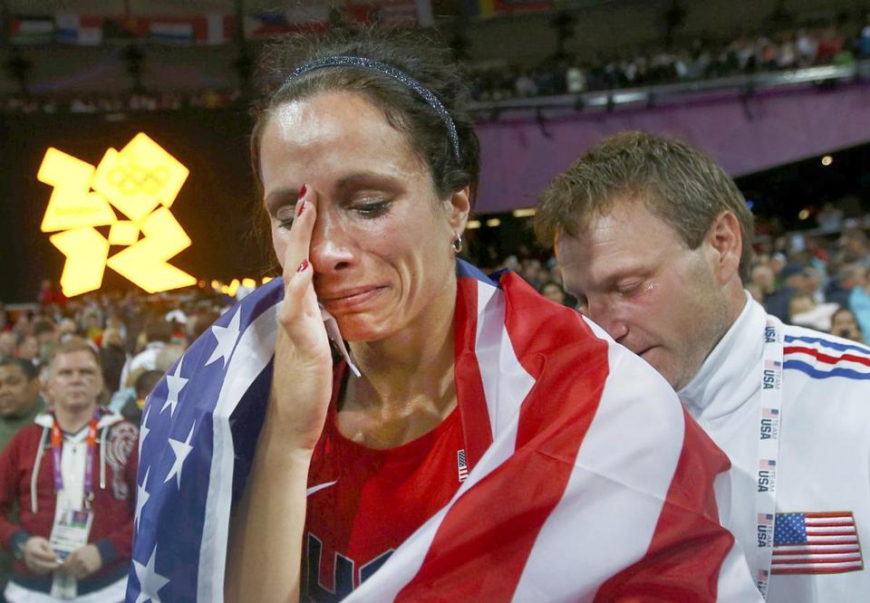 """If he could get out there and try to push me over the bar, he would,"" said Jenn Suhr, the US gold medalist in pole vault, on her husband and coach Rick. ""He's done so much for me. He cares so much."""