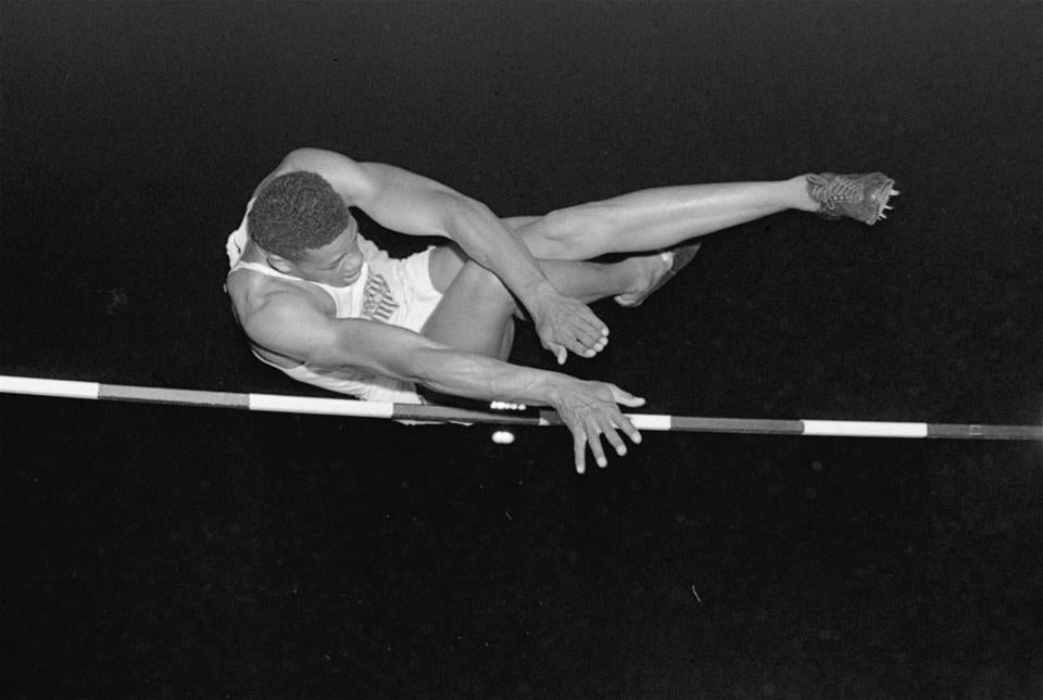 Mr. Campbell is shown competing in the high jump in 1952.