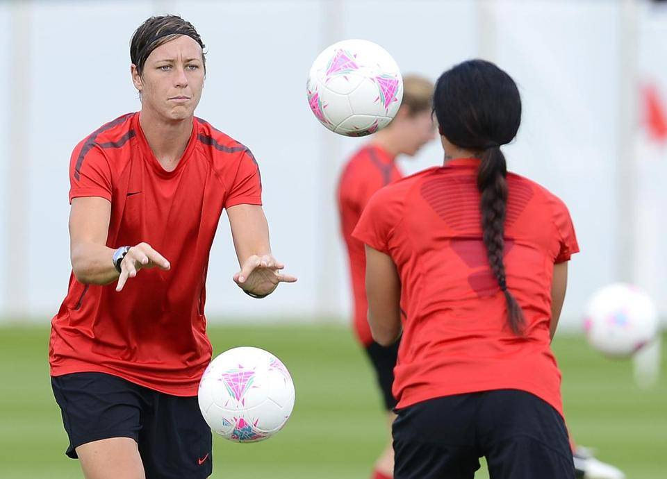 Abby Wambach (left) and Sydney Leroux have a ball while preparing for Thursday's game.