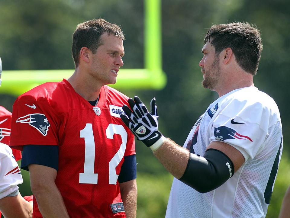 Tom Brady (left) will be in very good hands behind Dan Connolly & Co. once the games begin for real this season.