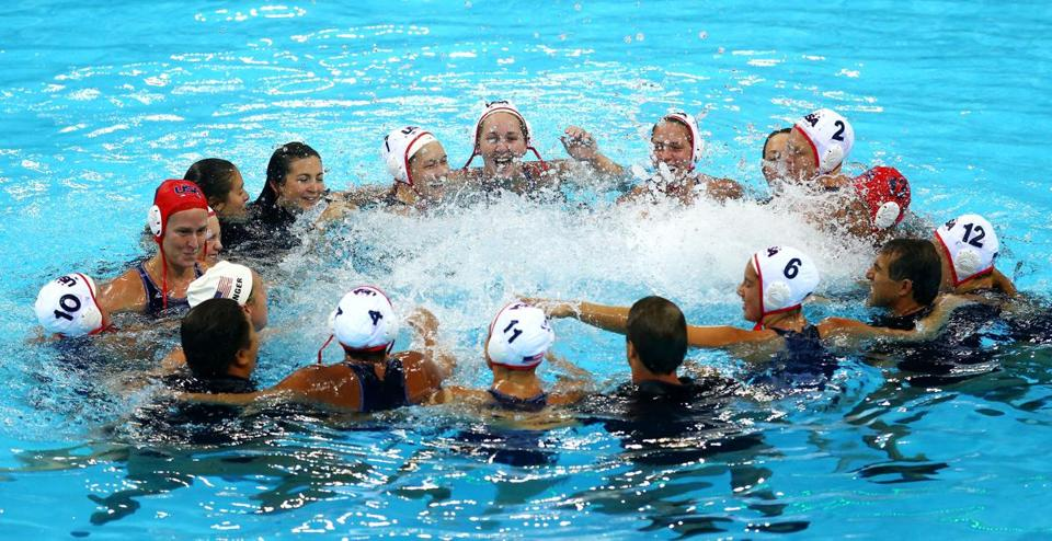 American players and coaches celebrate after the US women cruised by Spain to capture the gold medal for the first time.