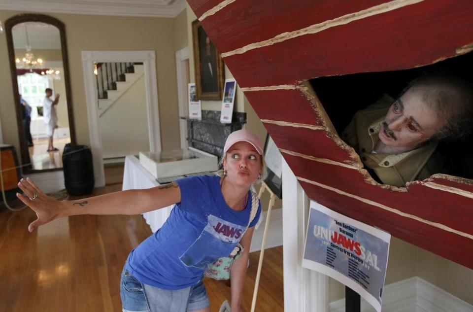 Fans of 'Jaws' traveled from all over to Martha's Vineyard, where the film was shot. Kaitlyn Crichton of Canada posed at an exhibit.