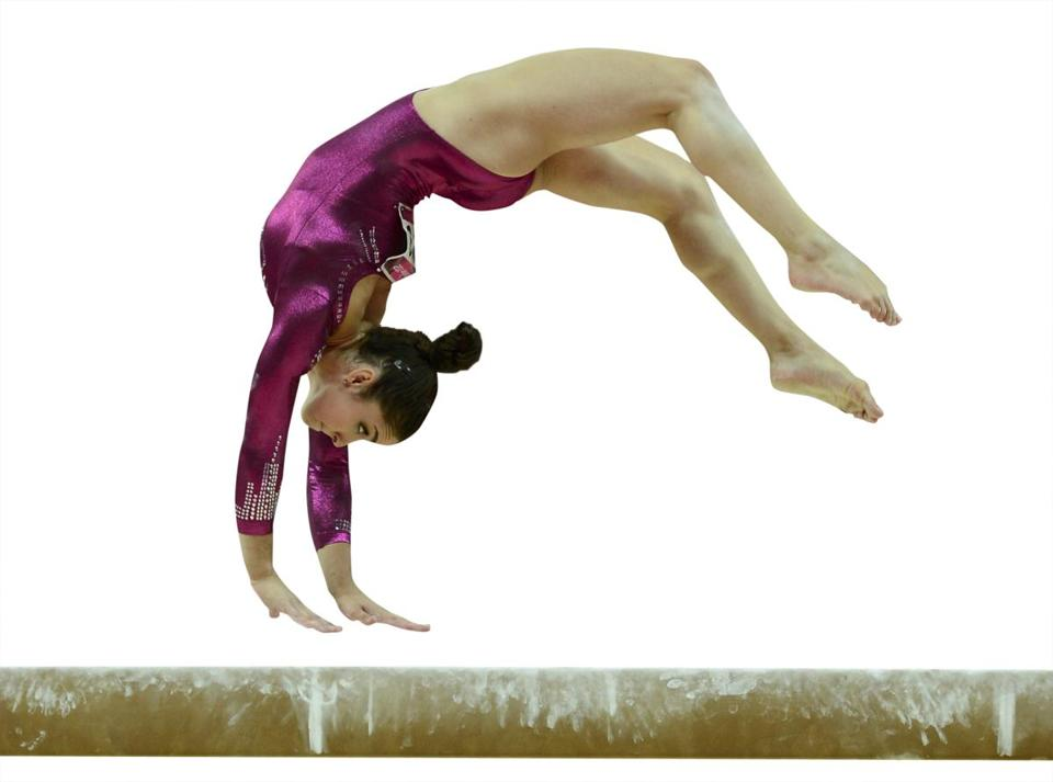 Aly Raisman performs on the balance beam during the women's individual all-around.