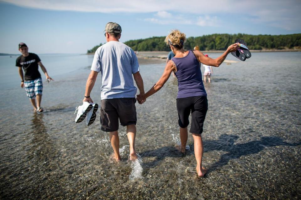 Craig and Rikki Carpenter enjoy the view from a sandbar in Bar Harbor, Maine. The town on the eastern side Mount Desert Island is a commercial and social hub.