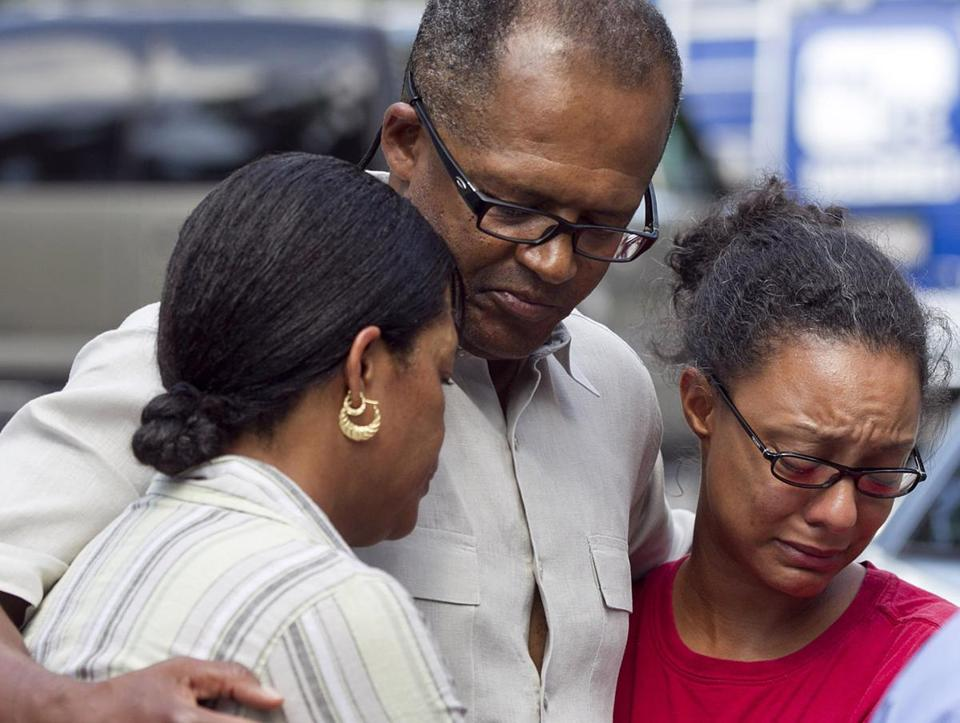 LaTeisha Adams, Rev. Gary Adams, and Danielle Bennett, reacted while City Councilor Charles Yancey addressed the media. They are relatives of Sharrice Perkins.