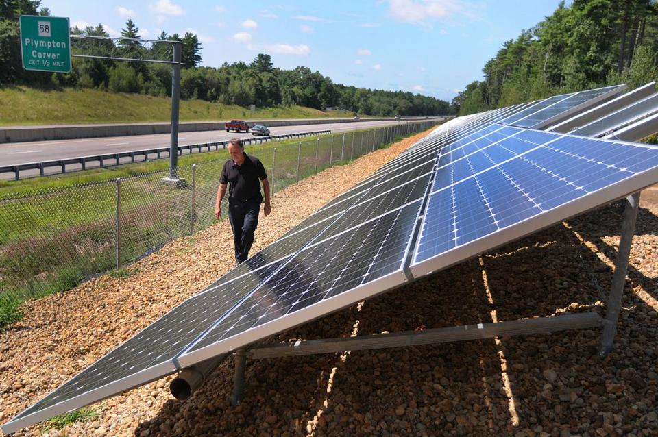 Jack Hunter, Carver's town planner, inspects the new solar panels set up along Route 44.
