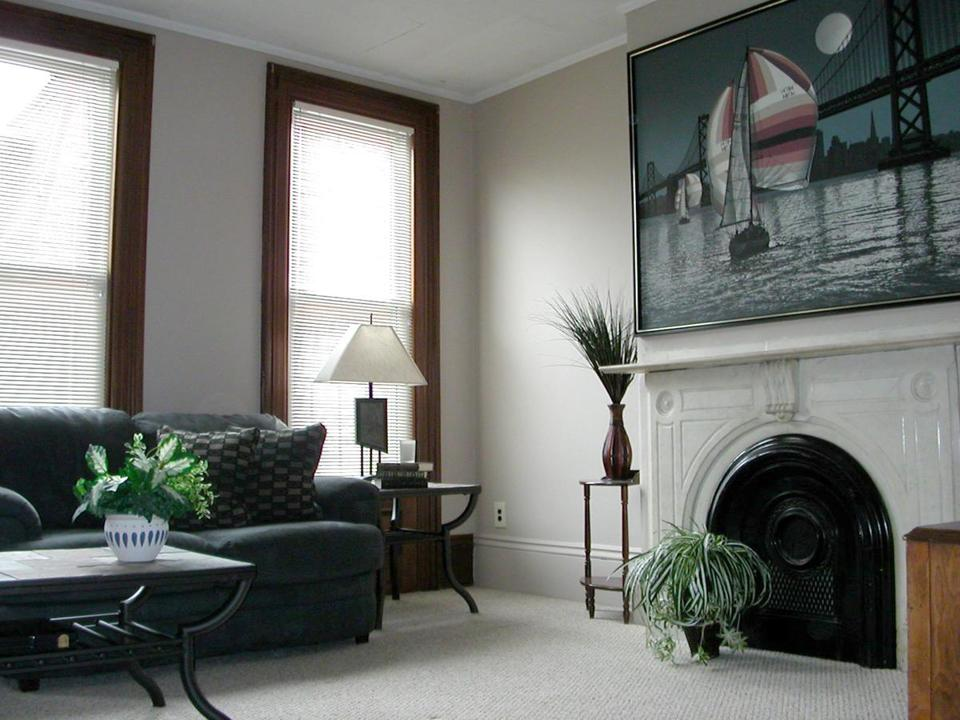 "The most dramatic changes to this South Boston room were new paint and carpet. ""Neutral colors give you a lot of flexibility, then you have freedom with what you do in the rest of the room."" ""This family didn't move furniture or art and the room still has a totally new feel."""