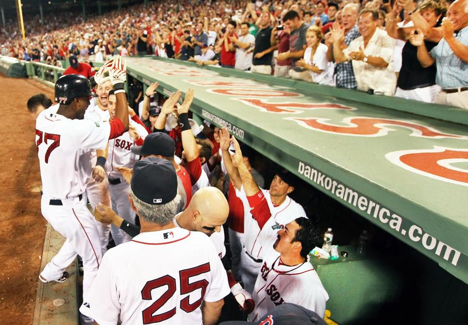 Pedro Ciriaco of the Red Sox got high fives after hitting a pinch-hit home run in the the eighth inning to give Boston a 3-2 lead over the Twins, at Fenway Park, Aug. 4, 2012.