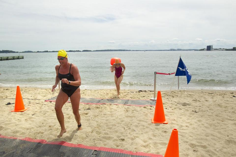Swimmers at the beach near the Curley Community Center in South Boston Aug. 19, 2012.