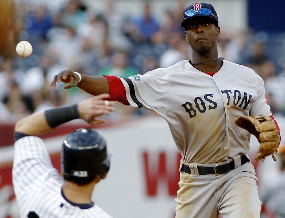 Red Sox shortstop Pedro Ciriaco throws over the top of Nick Swisher while turning a double play that ended the eighth.