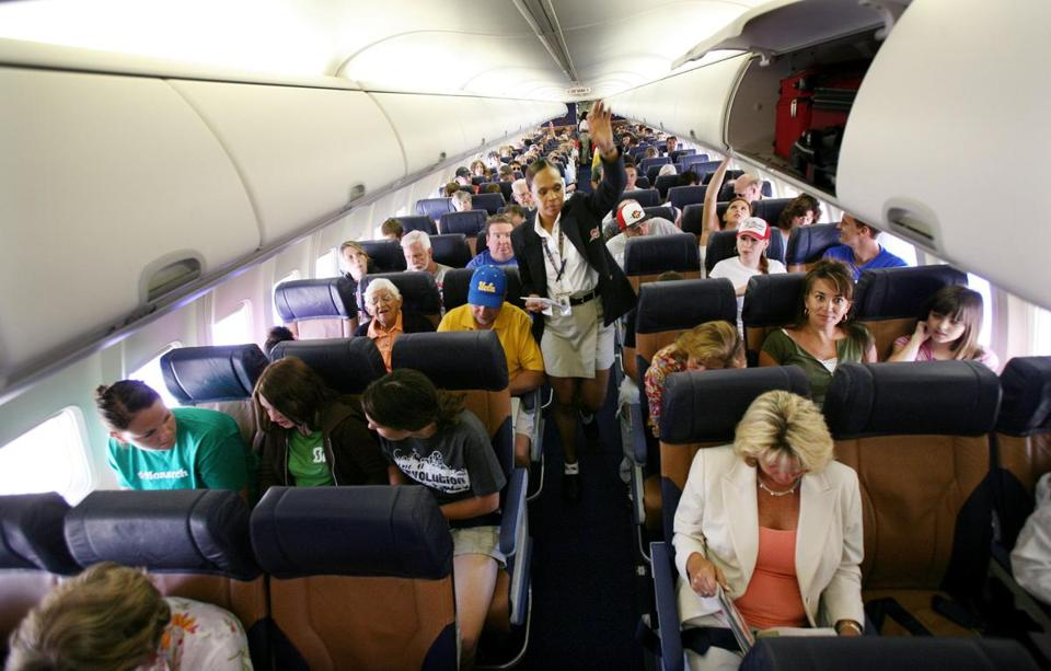 Passengers in economy class might notice a tighter fit as carriers reduce legroom to squeeze in more travelers.