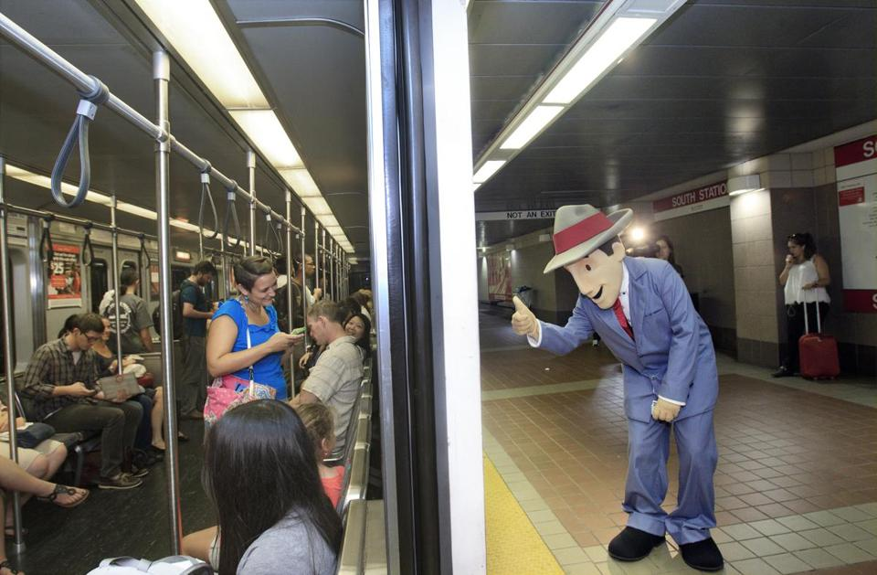 Charlie, the mascot for the MBTA, greeted T passengers and handed out CharlieCards during his debut Wednesday at South Station.