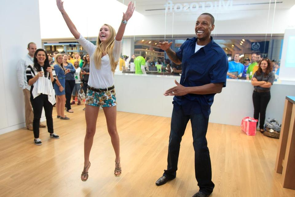 Lauren Wanthal of Andover gets to play video games with Celtics star Paul Pierce at the new Microsoft store at the Prudential Center.