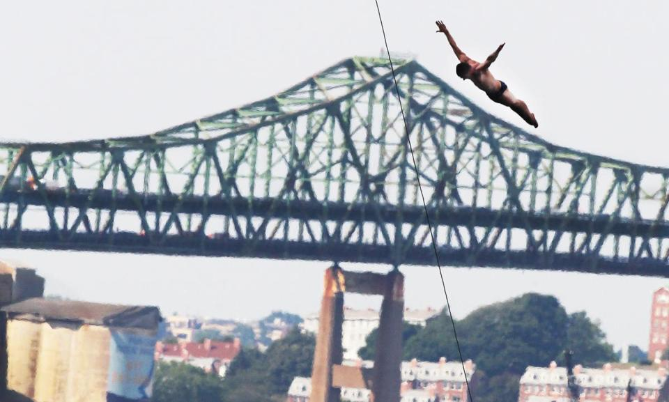 David Colturi, 23, of Ann Arbor, Mich., practicing for the Red Bull Cliff Diving World Series at the Institute of Contemporary Art, Aug. 23., with the Tobin Bridge as a backdrop.