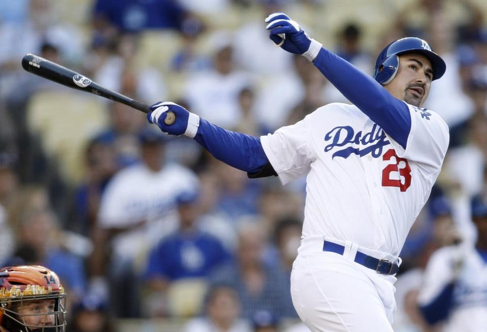 On the day his trade from the Red Sox became official, Adrian Gonzalez was quickly inserted into the Dodgers' lineup, hitting a three-run homer in his first at-bat against the Marlins.