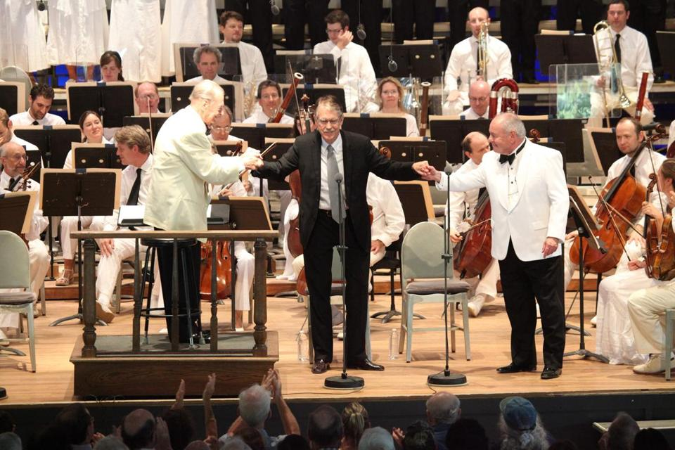 "John Harbison takes a bow following the premiere of his ""Koussevitzky Said:,"" with Rafael Frühbeck de Burgos (left) and John Oliver (right) at Tanglewood."