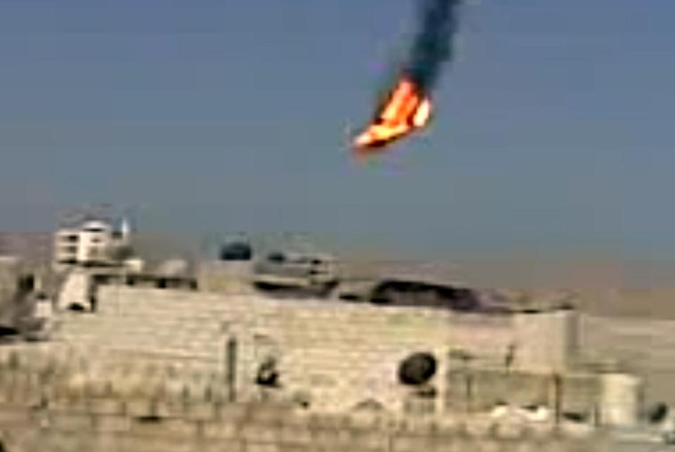 This image from a citizen journalism video reportedly shows a Syrian military helicopter on fire and falling to the ground after being hit during fighting in Damascus.