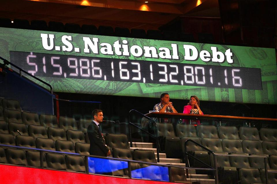 A sign showed the national debt total Monday inside the Tampa Bay Times Forum, site of the GOP convention.