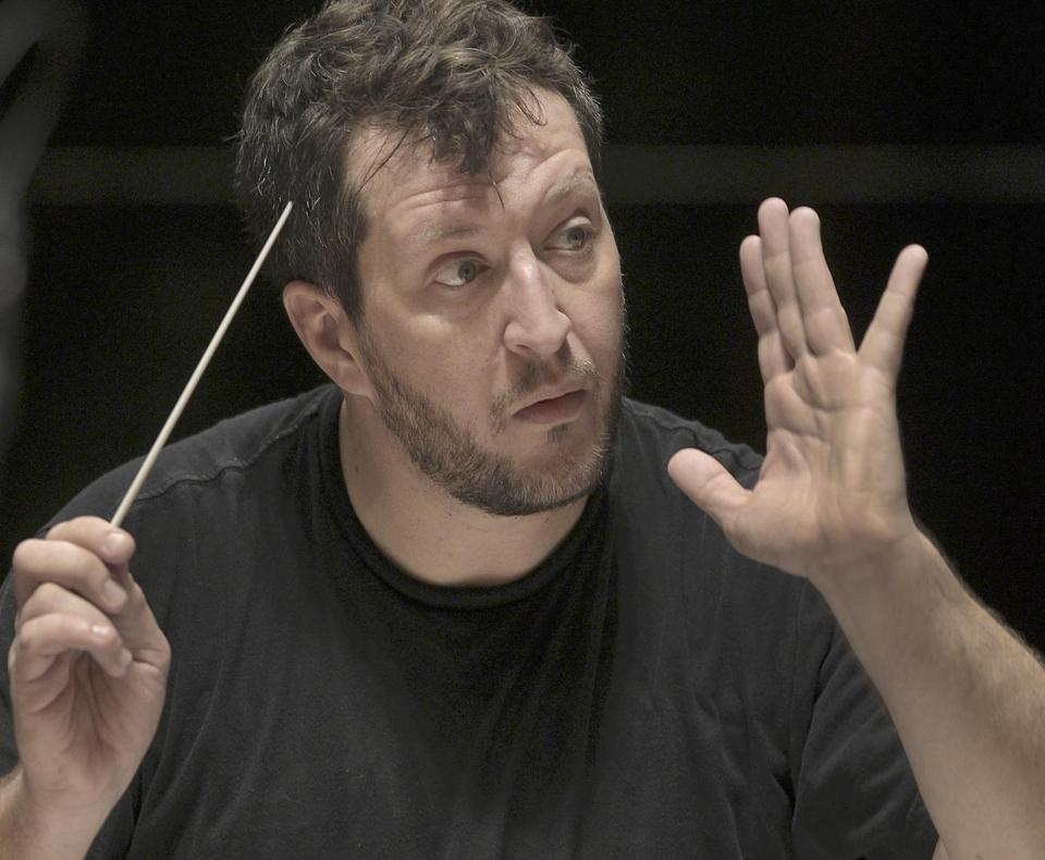 "Thomas Adès, shown rehearsing with the BSO before a memorable performance in 2011, returns this year with his piano concerto ""In Seven Days"" as the program's centerpiece."
