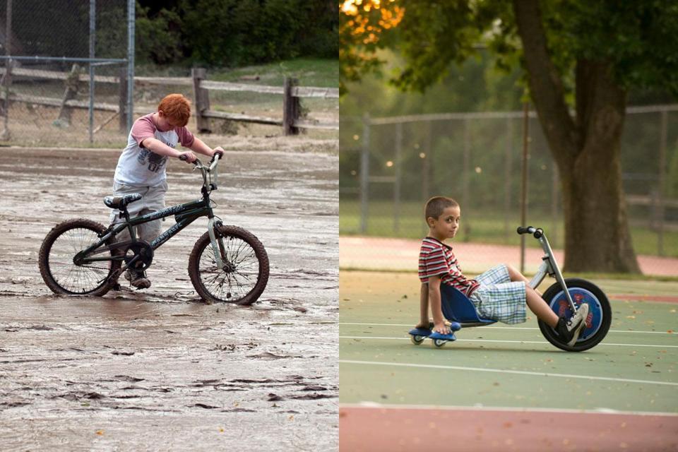 Last year, Chris Webster (left) tried to ride his bike on a flooded playground in Rutland, Vt. Residents have mostly rebuilt over the damage.