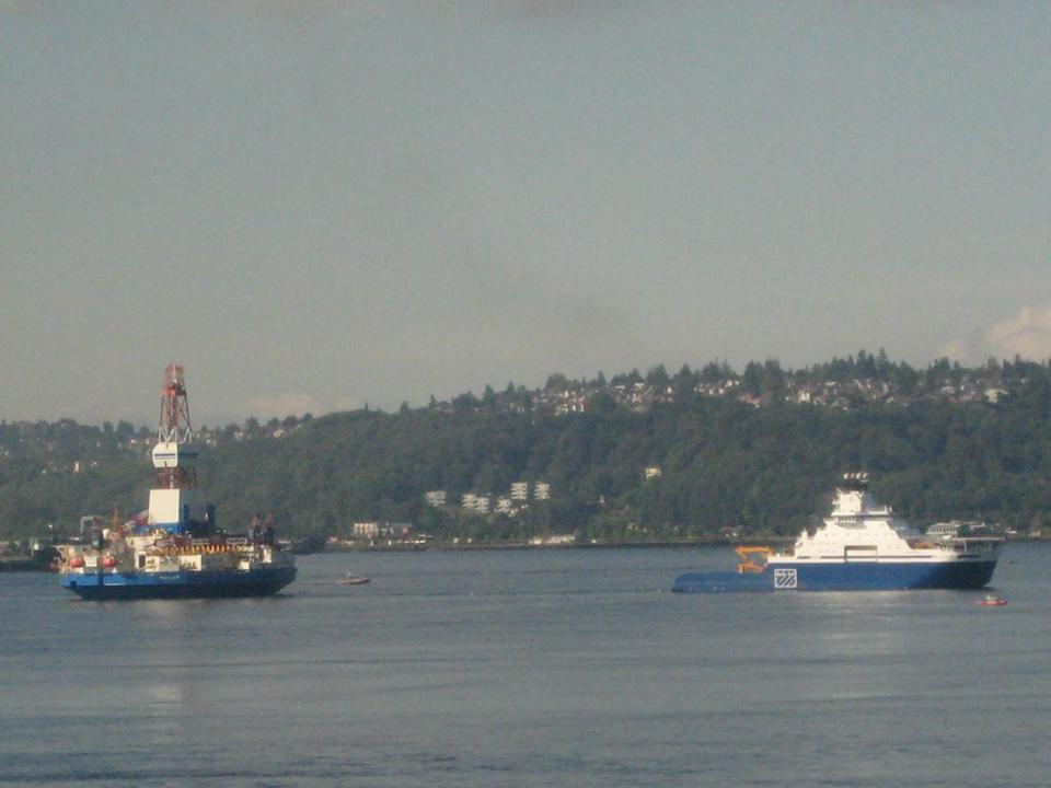 Ships bringing oil drilling equipment to Alaska pass through Seattle's Elliot Bay. Reduced Arctic sea ice, due to a warming trend, has fueled interest in oil exploration.