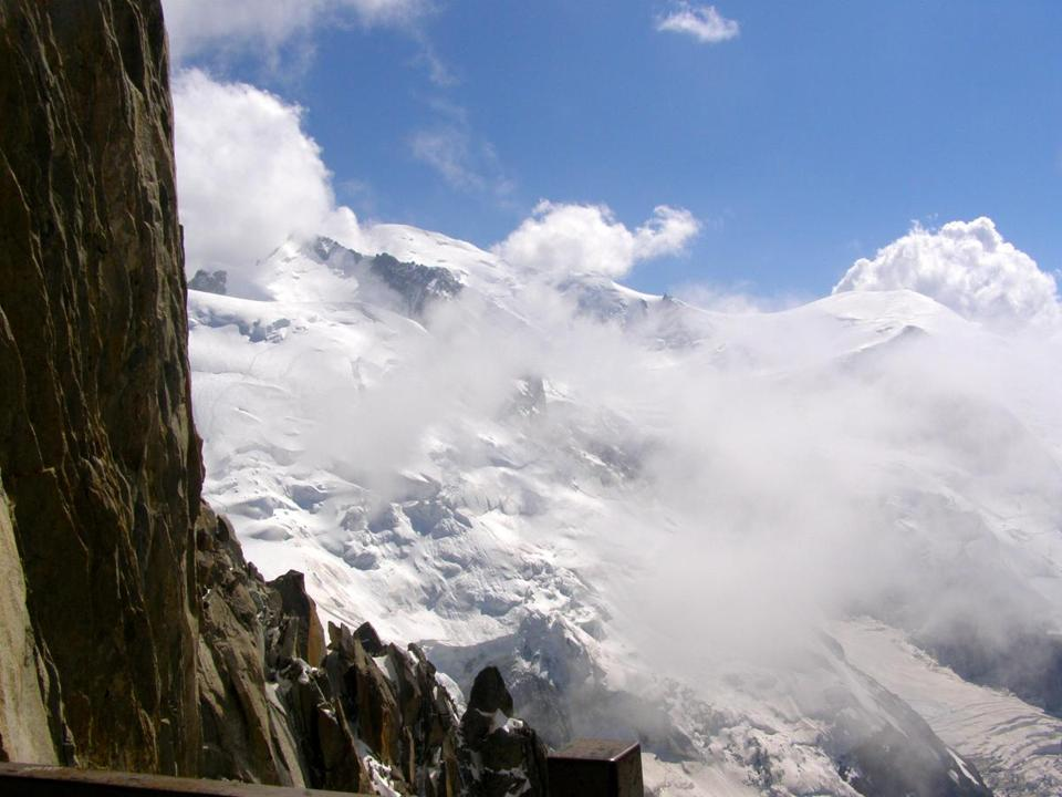 Mont Blanc seen from atop the Aiguille du Midi as afternoon clouds move in.