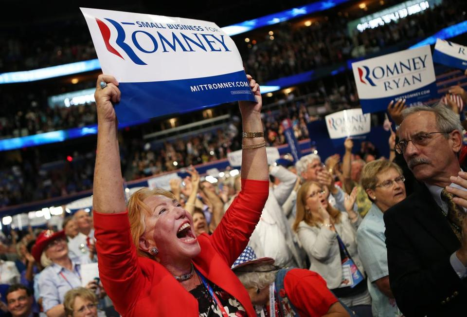 A woman holds a sign as Paul Ryan spoke during the third day of the Republican National Convention Wednesday.