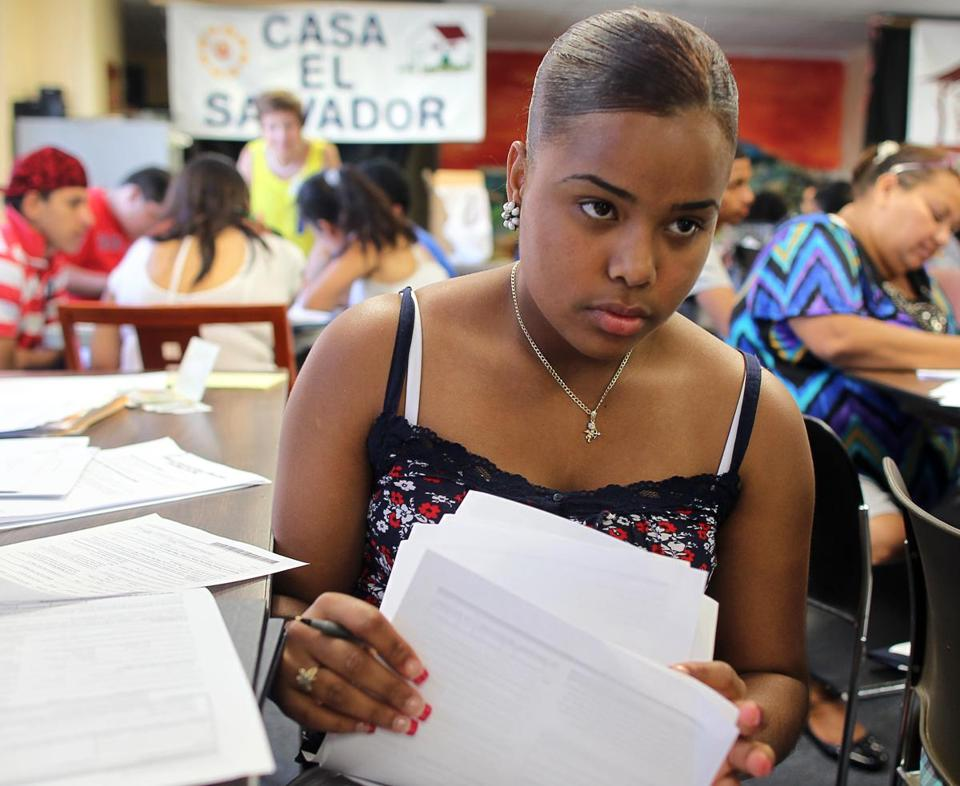 Winda Moscat, 18, went through application papers. She wants to attend college and pursue a career.