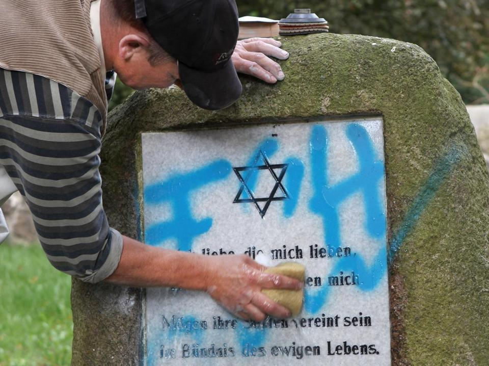 A tombstone was cleaned at a Jewish cemetery near Rostock, Germany, after it was defaced.