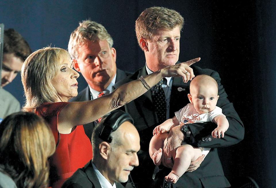 Edward M. Kennedy's sons, Edward Jr. (center) and Patrick, spoke with news anchor Andrea Mitchell at the convention on Tuesday. Patrick Kennedy was holding his 4-month-old son, Owen. The convention's opening night featured a video tribute to the late senator.