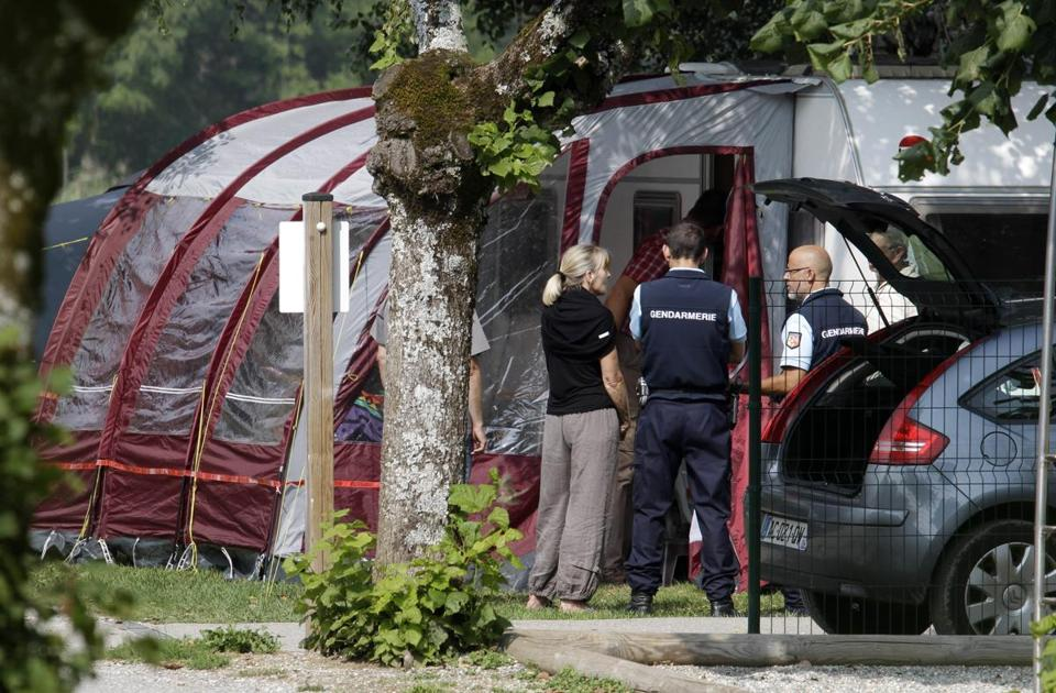 Investigators stood at the camp site where the slain British family was vacationing in Saint Jorioz, near Annecy, France, on Thursday.