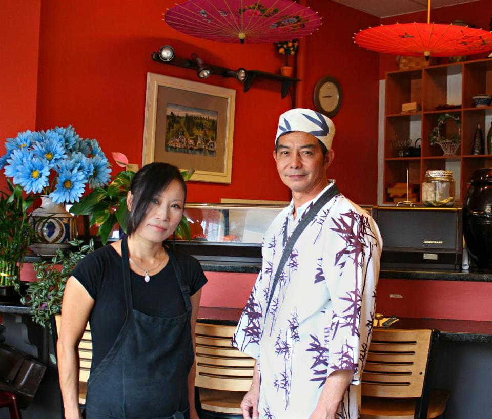 Suk Grindle, owner and chef at Korean Grille in Quincy, with Jacki Chen Fang, the sushi chef.