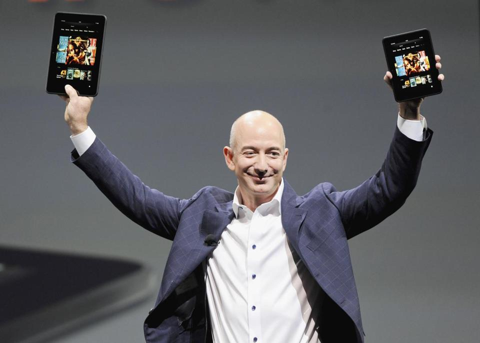 Amazon chief executive Jeff Bezos displayed the two new Kindle Fire readers Thursday in Santa Monica, Calif.