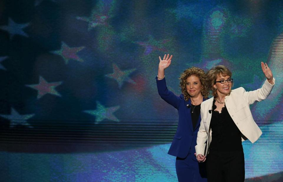 Former Representative Gabrielle Giffords (right) waved after reciting the Pledge of Allegiance at the Democratic National Convention.  )