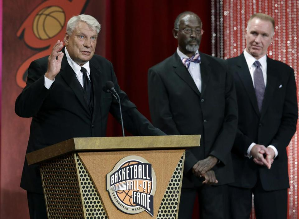 Don Nelson, left, spoke during the enshrinement ceremony for the 2012 class of the Naismith Memorial Basketball Hall of Fame as Satch Sanders and Chris Mullin listened at Symphony Hall in Springfield Friday.
