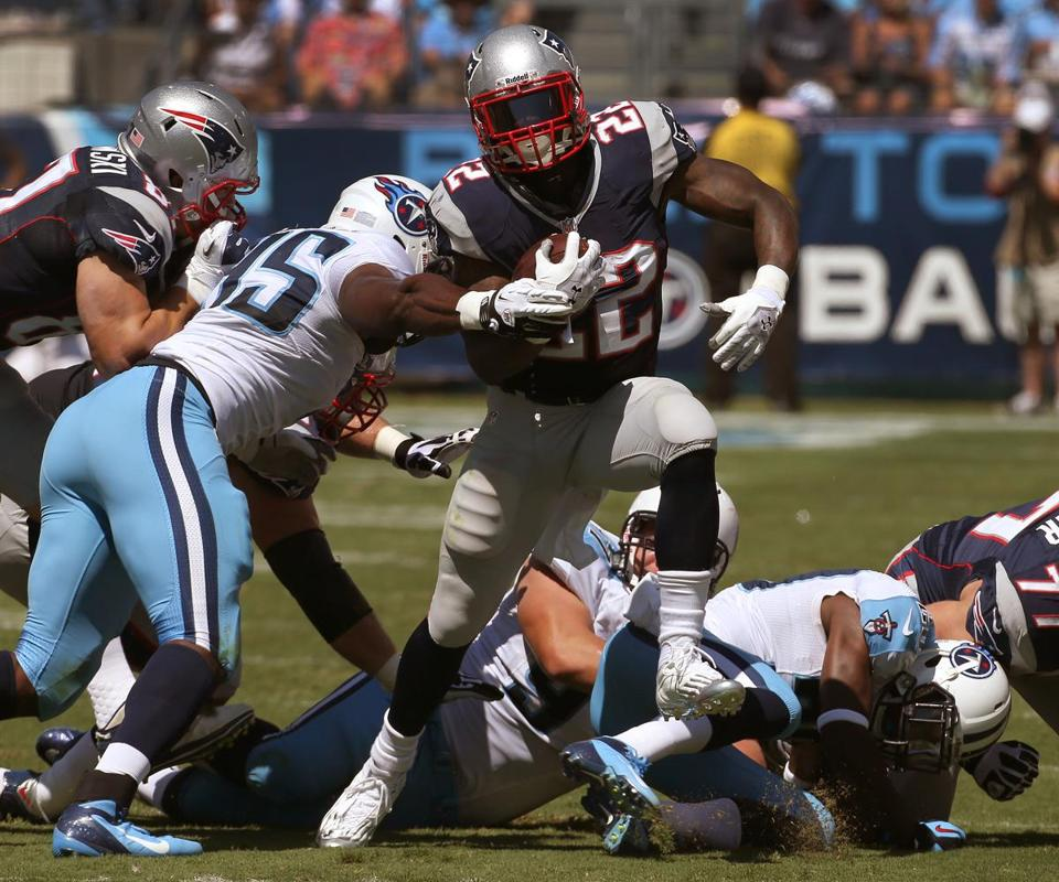 Stevan Ridley breaks a tackle on a 17-yard first-quarter run during a Patriots TD drive. The back ended up with 125 yards on 21 carries.
